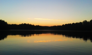 Travel stories Lake in Savitaipale, Finland at sunrise. Magoro graphics